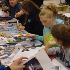 9th graders cutting collage